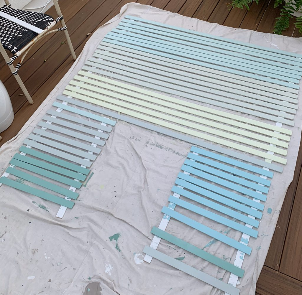 Painted Lattice Strips Laid Out On Deck In Various Blue Green And Gray Colors