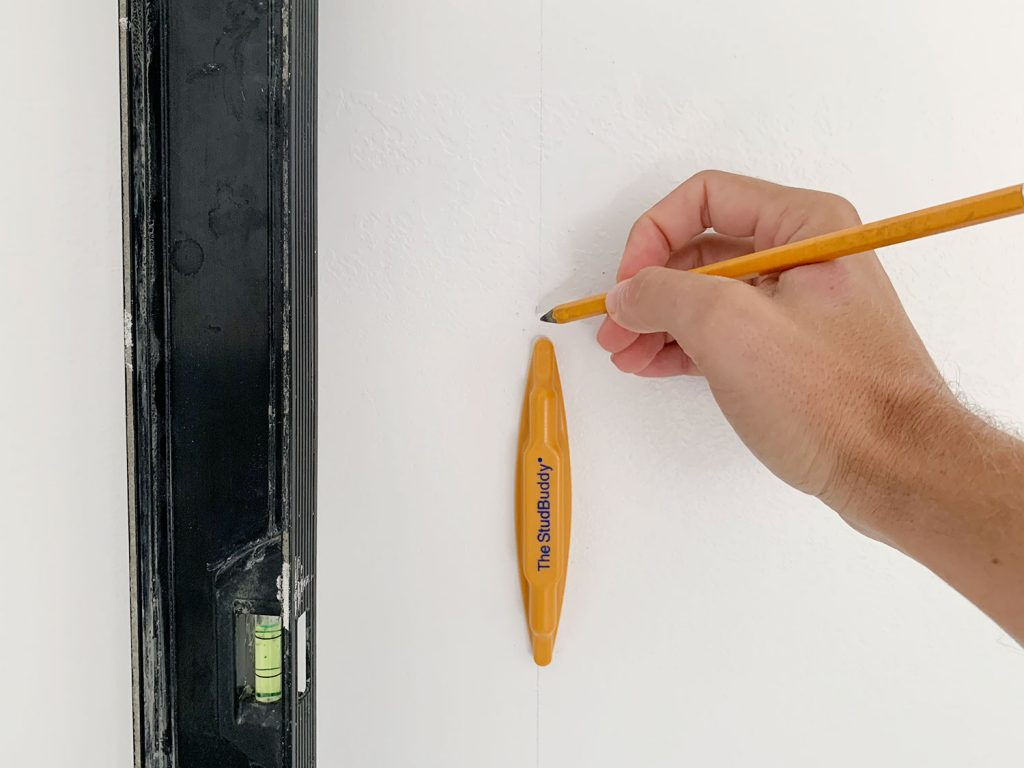 Hand Marking Vertical Level Line On Wall Using StudBuddy Stud Finder