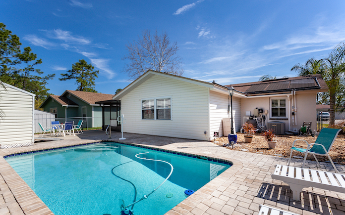 Jacksonville, Florida / USA - May 2 2020: Nice in-ground pool in residential backyard