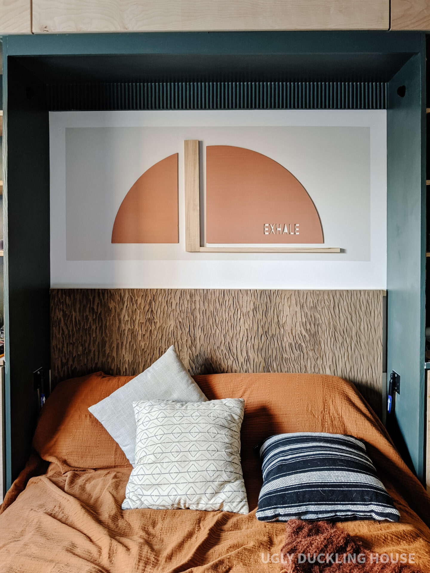 murphy bed nook reveal - exhale rust arch color block art and carved wood headboard with neutral bedding and rust coverlet