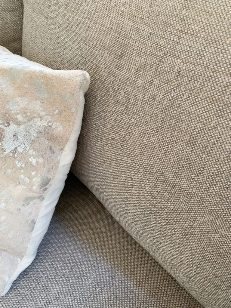 Detail of gray fabric on loveseat